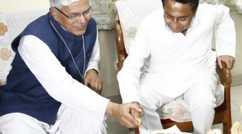 Archbishop Leo Cornelio of Bhopal cuts a cake with Kamal Nath, the newly installed chief minister of Madhya Pradesh state in central India when the politician visited the Archbishop's House on Christmas Day. (Photo supplied)