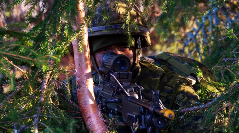 A sapper assigned to 5 Combat Engineer Regiment, Canadian Military Engineers, mans his gun during NATO exercise Trident Juncture in Kivkne, Norway. Photo Credit: Navy Petty Officer 1st Class Abraham Essenmacher