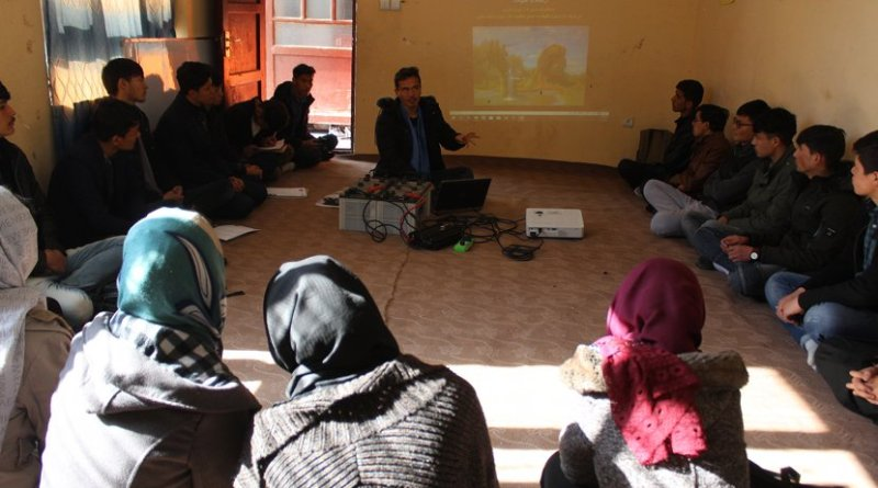 """Muhammad Ali teaching a """"relational learning circle"""" class during orientation at the APV Borderfree Center. Photo credit: Dr. Hakim"""