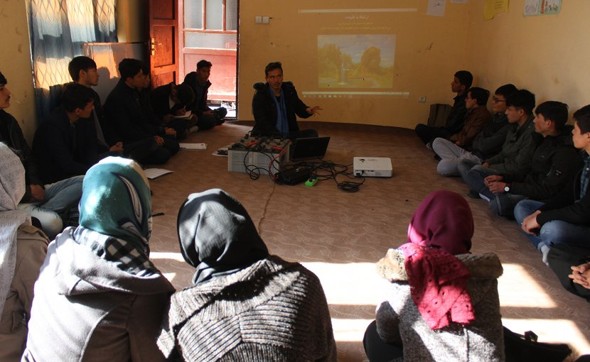 "Muhammad Ali teaching a ""relational learning circle"" class during orientation at the APV Borderfree Center. Photo credit: Dr. Hakim"