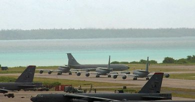 A B-2 bomber takes off, with B-52 bombers on tarmac on Diego Garcia. Photo Credit: U.S. Air Force photo by Senior Airman Nathan G. Bevier