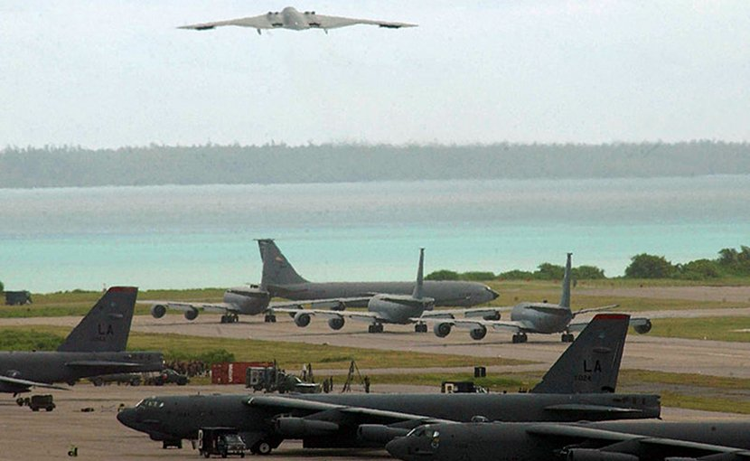 B-2 bomber take off, B-52 bombers on tarmac on Diego Garcia. Photo Credit: U.S. Air Force photo by Senior Airman Nathan G. Bevier