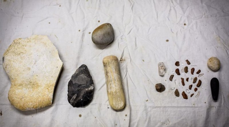 The iconic, tear-drop shaped hand axe, which filled a human palm, required a large toolkit to produce (left), in contrast to a toolkit for tiny flakes. Credit Emory University