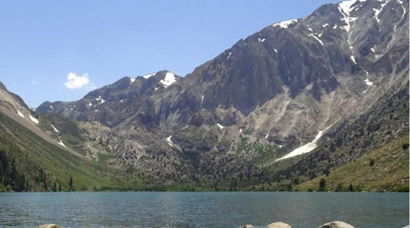 Looking southwest across Convict Lake, Mono County, California, toward Laurel Mountain and the upturned meta-sedimentary strata under which some of the seasonal swarms occur. Credit Emily Montgomery-Brown
