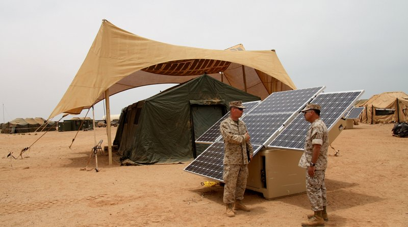 Maj. Sean M. Sadlier (left) of the U.S. Marine Corps Expeditionary Energy Office explains the solar power element of the Expeditionary Forward Operating Base concept to Col. Anthony Fernandez during the testing phase of this sustainable energy initiative. May 19, 2010. (by U.S. Marine Corps/Maj. Paul Greenberg)