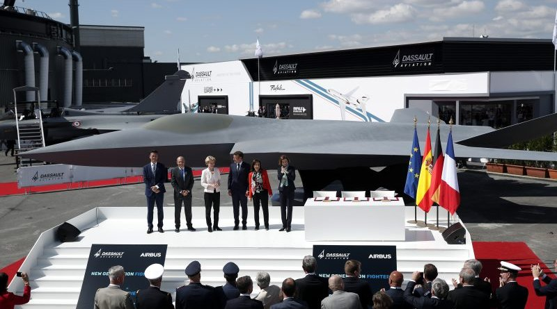 Airbus Defence and Space Chief Executive Officer Dirk Hoke, Dassault Aviation Chairman and CEO Eric Trappier, German Defense Minister Ursula von der Leyen, French President Emmanuel Macron, Spanish Defence Minister Margarita Robles and French Defence Minister Florence Parly attend the unveiling of the French-German-Spanish new generation fighter model during the 53rd International Paris Air Show at Le Bourget Airport near Paris, France, 17 June 2019. Credit: Pool photo
