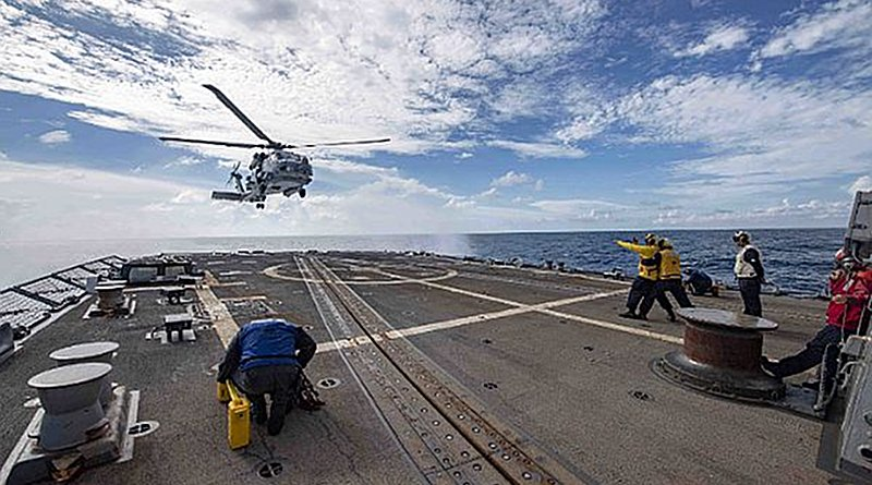 An MH-60R Sea Hawk helicopter assigned to the Saberhawks of Helicopter Maritime Strike Squadron (HSM) 77 lands on the flight deck aboard the Arleigh Burke-class guided-missile destroyer USS McCampbell (DDG 85). McCampbell is forward-deployed to the U.S. 7th Fleet area of operations in support of security and stability in the Indo-Pacific region. (U.S. Navy photo by Mass Communication Specialist 3rd Class Isaac Maxwell/Released)