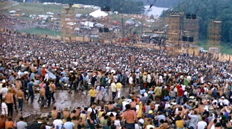 Woodstock festival site with the stage. Photo Credit: Derek Redmond and Paul Campbell, Wikipedia Commons.