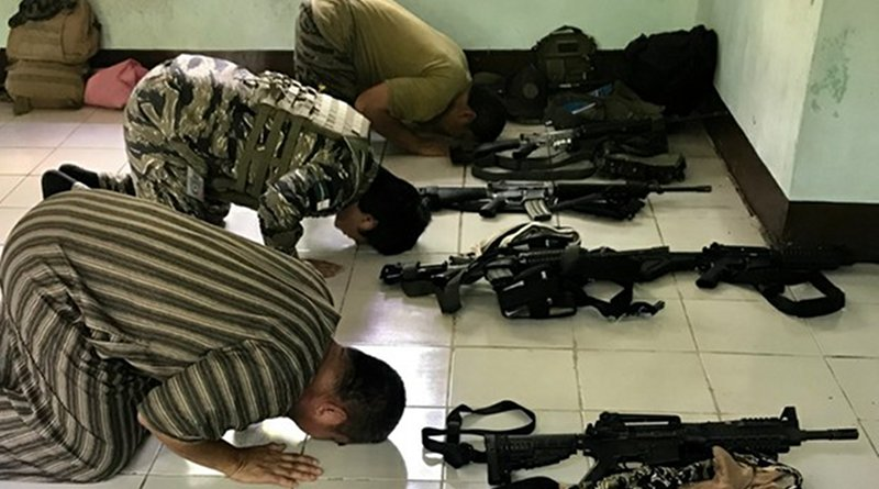 Moro Islamic Liberation Front fighters bow in prayer at a mosque inside Camp Darapanan, Philippines. Photo Credit: Jason Gutierrez / BenarNews