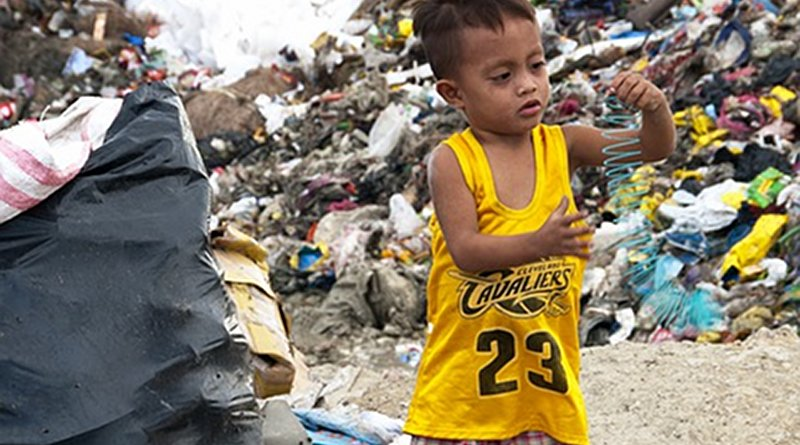 File photo of a child in a garbage dump in the Philippines.