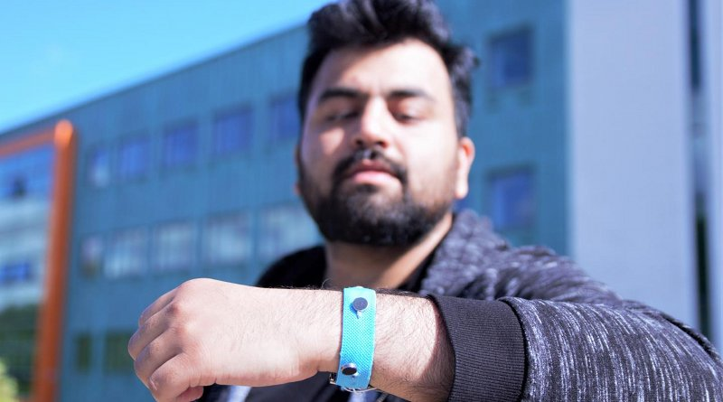 Co-creator Muhammad Umair wearing one of the prototype smart materials wrist bands. Credit Paul Turner/Lancaster University