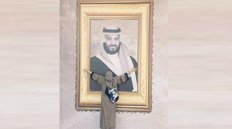 The viral picture showing Munira Abdullah hugging a giant portrait of Crown Prince Mohammed bin Salman. (Supplied photo)
