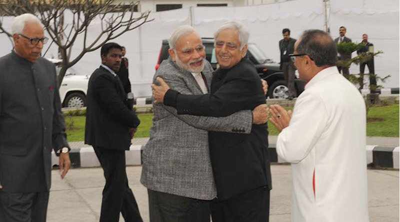 Prime Minister Narendra Modi arrives at the swearing-in ceremony of Mufti Mohammad Sayeed as Jammu&Kashmir Chief Minister, at Jammu University, in Jammu and Kashmir on March 1, 2015. The J&K Governor N.N. Vohra is also seen. Credit: India Prime Minister's Office.
