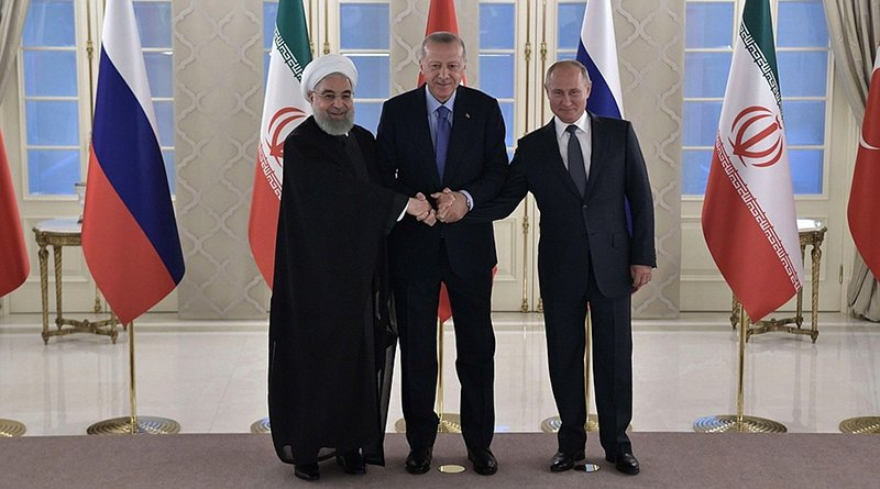 Meeting between the leaders of the guarantor states of the Astana process on the settlement in Syria. Russian President Vladimir Putin with President of Turkey Recep Tayyip Erdogan (centre) and President of Iran Hassan Rouhani. Photo Credit: Kremlin.ur