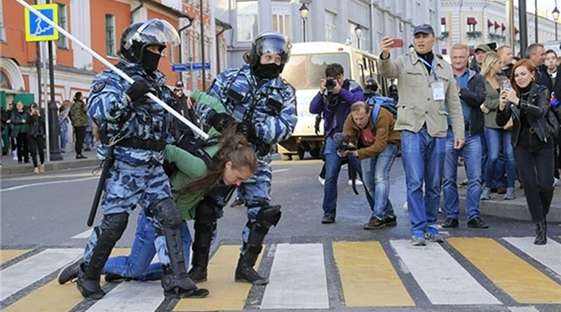 Russian security forces arrest woman protestor in Moscow, Russia. Photo Credit: Fars News Agency