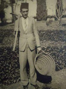 Faredoon Nooreyezdan, working in the gardens of the Shrine of the Bab on Mount Carmel, Haifa, in 1936.