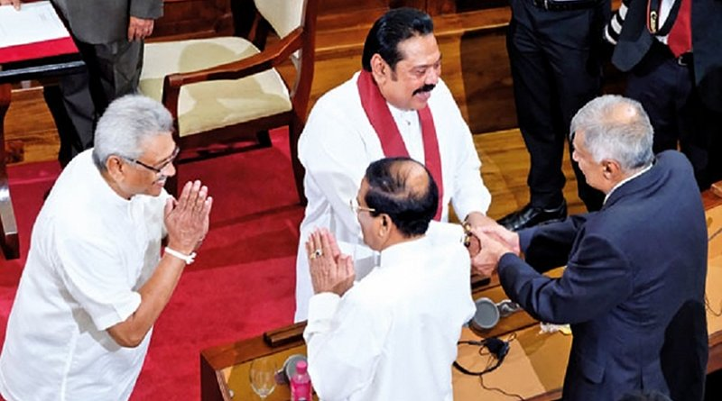 Sri Lanka's former Prime Minister Ranil Wickremesinghe congratulating his successor Mahinda Rajapaksa soon after he was sworn in at the Presidential Secretariat. With them are new President Gotabaya Rajapaksa and former President Maithripala Sirisena. Photo Credit: Sri Lanka government