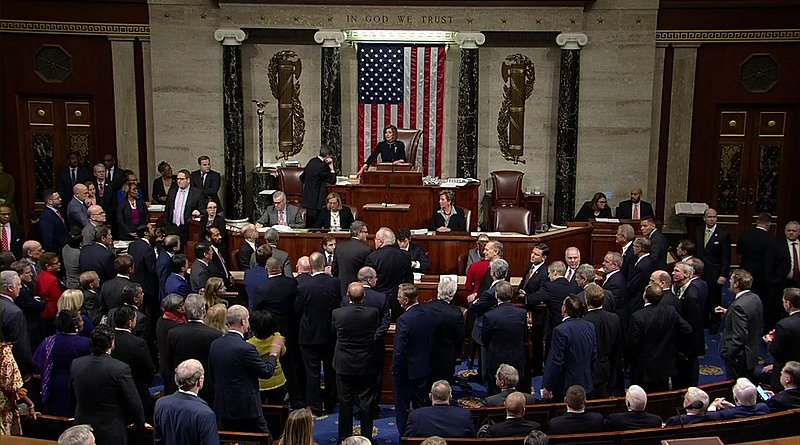 On December 18, 2019, United States House of Representatives votes to adopt the articles of impeachment, accusing Donald Trump of abuse of power and obstruction of Congress. Photo Credit: United States House of Representatives, Wikipedia Commons.