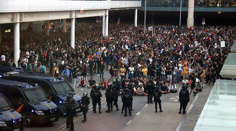 Catalan protestors at Barcelona airport. Photo Credit: Medol, Wikipedia Commons