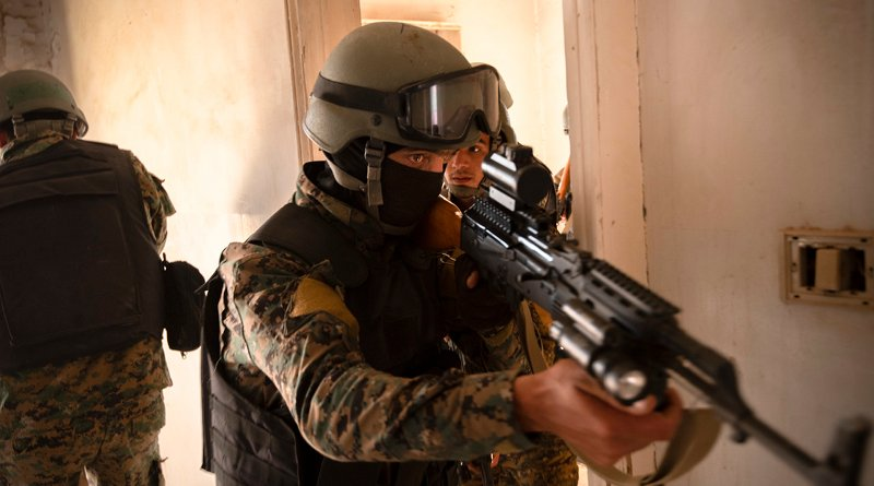 Syrian Democratic Forces commando cadets clear a room during training for military operations in urban terrain in Syria. Photo Credit: Army Spc. Alec Dionne