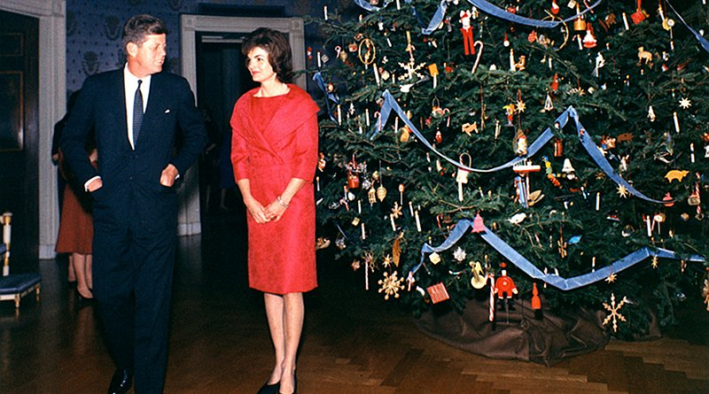 President John F. Kennedy and First Lady Jacqueline Kennedy with the first themed Blue Room tree in 1961. Photo Credit: The White House, Kennedy Library, Wikipedia Commons