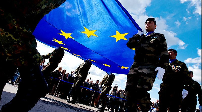 Soldiers carrying the EU flag. Photo Credit: European Union 2014 - European Parliament, Flickr