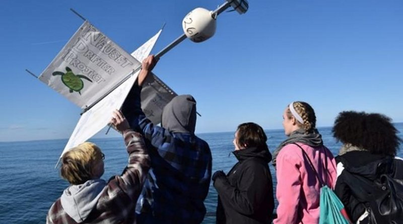 High school students from Nauset Regional High School in Eastham, Massachusetts releasing a drifter into Cape Cod Bay in 2016. Mass Audubon's Wellfleet Bay Wildlife Sanctuary worked with the students to study surface currents relative to sea turtle strandings in the fall. CREDIT Olivia Bourque