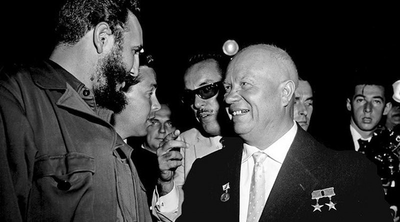 In the Assembly Hall shortly before the meeting got under way, Premier N.S. Khrushchev (right), Chairman of the Council of Ministers of the USSR, and Premier Fidel Castro, of Cuba, are seen greeting each other. UN Photo. 20 September 1960. United Nations, New York.