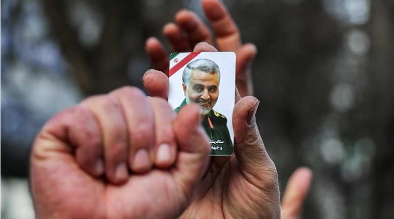 Mourner holds photo of commander of the Quds Force of the Islamic Revolution Guards Corps (IRGC), Qassem Soleimani. Photo Credit: Tasnim News Agency