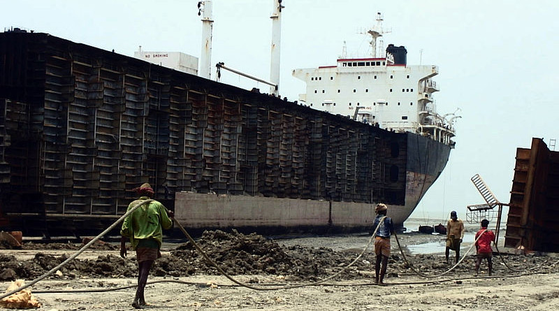 Workers drag steel plate ashore from beached ships in Chittagong, Bangladesh. Photo Credit: Stéphane M Grueso, Wikipedia Commons
