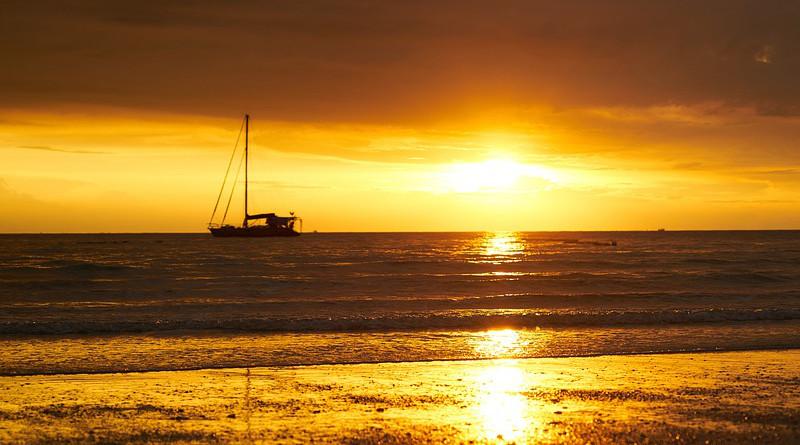 malaysia sunset boat ocean