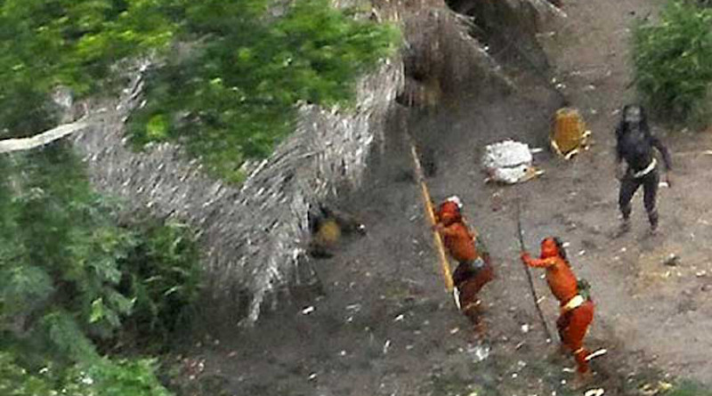 This uncontacted indigenous group in the Brazilian Amazon is clearly hostile to the helicopter hovering overhead. Photo credit: TravelingMan on VisualHunt / CC BY-NC-ND.