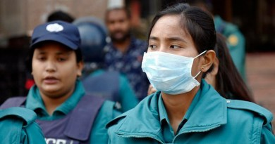 A Bangladeshi policewoman in Dhaka wears a mask to guard against the novel coronavirus. Photo Credit: BenarNews