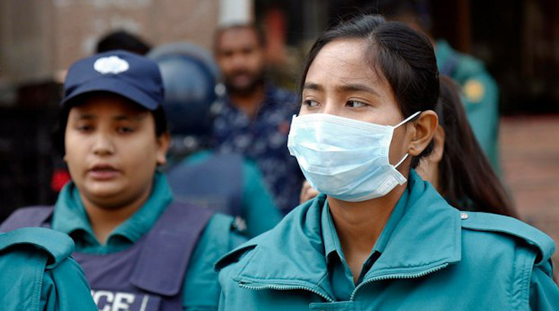 A Bangladeshi policewoman in Dhaka wears a mask to guard against the novel coronavirus. Photo Credit: BenarNews