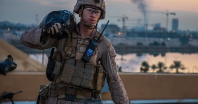 Marine with 2nd Battalion, 7th Marines, carries sandbag to strengthen security post during reinforcement of U.S. Embassy Compound in Baghdad, January 4, 2020 (U.S. Marine Corps/Kyle C. Talbot)