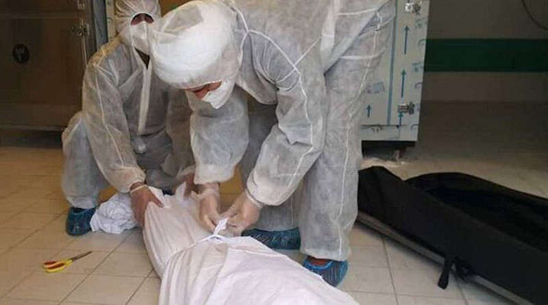 Health workers in Iran with a coronavirus victim. Photo Credit: IRNA