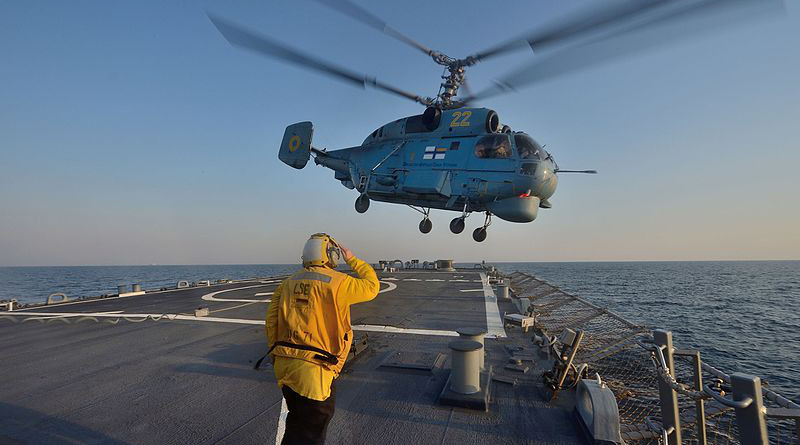 Boatswain's Mate 3rd Class Jennifer Sahley salutes as a Ukrainian navy helicopter. Photo Credit: U.S. Navy photo by Mass Communication Specialist 2nd Class John Herman/Released