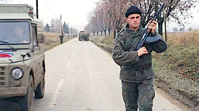 A Serbian paramilitary patrolling in Erdut, eastern Slavonia, 1991. Photo Credit: Peter Denton, Wikipedia Commons