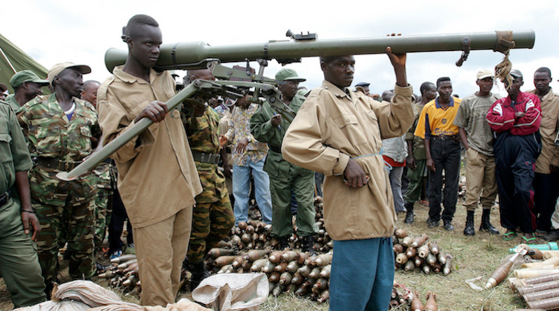 Members of CNDD-FDD rebel forces surrender their weapons and ammunition to United Nations Operation in Burundi (ONUB) peacekeepers in Mbanda, southern Burundi. 03 February 2005. UN Photo/Martine Perret.