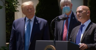 Dr. Moncef Slaoui speaks about coronavirus vaccine development in the Rose Garden of the White House while US President Donald Trump listens. Photo Credit: Screenshot White House video