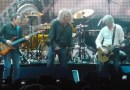Led Zeppelin in 2007, from left to right: John Paul Jones, Robert Plant, and Jimmy Page (Jason Bonham is obscured, sitting at the drum set). Photo Credit: p_a_h, Wikipedia Commons.