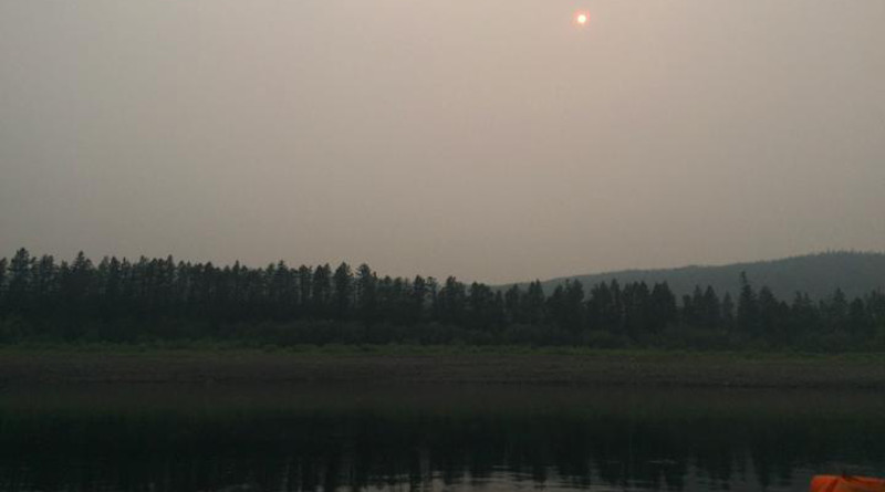 View of Siberian waterway after a forest fire -- smoke and soot linger in the air for several days even after rainfall. UNH researchers find aftereffects of a burn can last up to five decades and could have major implications on vital waterways. CREDIT: Bianca Rodriguez-Cardona/UNH