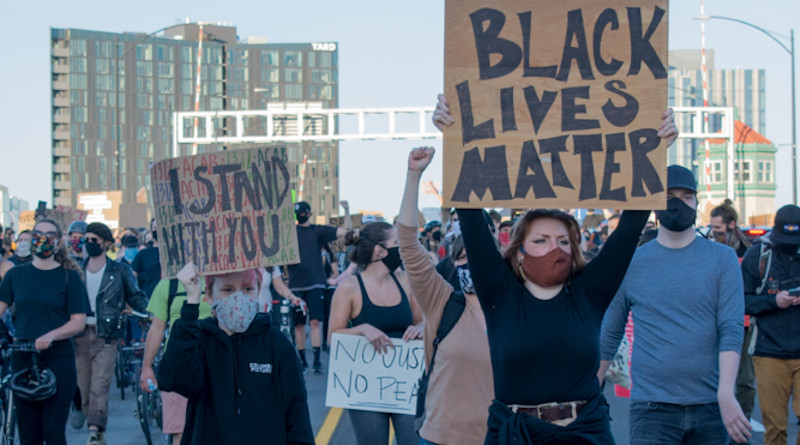 Black Lives Matter protesters cross the Burnside Bridge in Portland, Oregon. Protests in the aftermath of the killing George Floyd. Photo Credit: Henryodell, Wikipedia Commons
