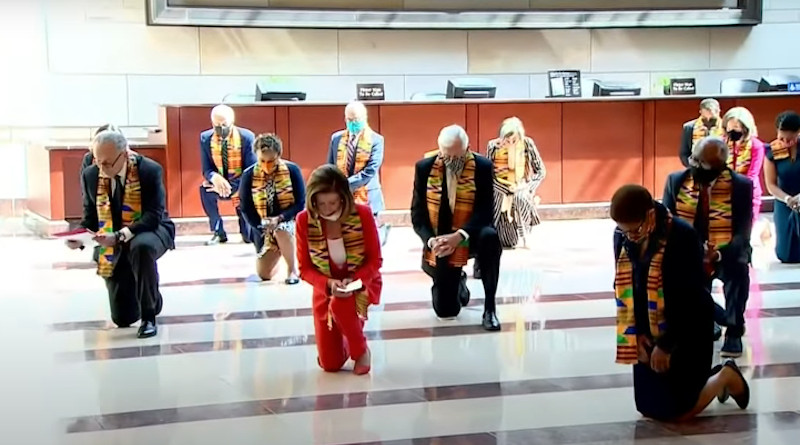 Speaker of the United States House of Representatives Nancy Pelosi and Congressional Black Caucus Democrats kneel for 8 minutes 46 seconds to honor George Floyd wearing kente cloth.