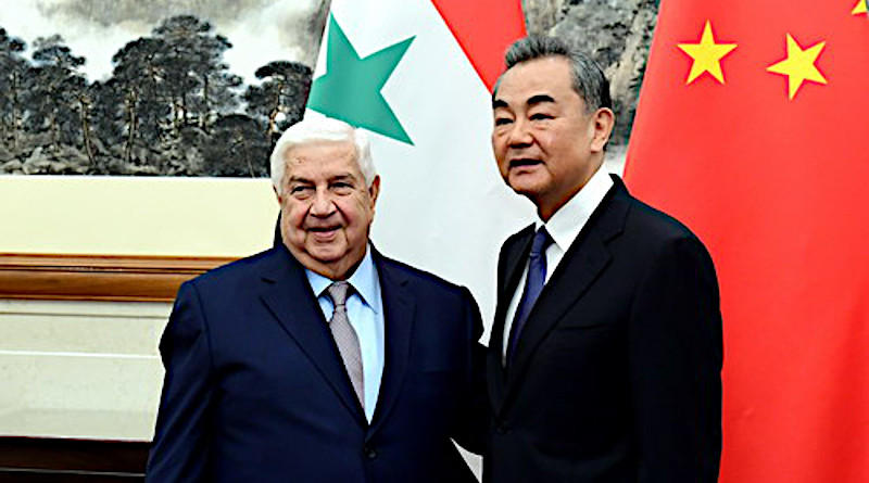 File photo of Foreign Minister Walid Muallem of Syria (left) and China's State Councilor and Foreign Minister Wang Yi. Photo Credit: Chinese Foreign Ministry