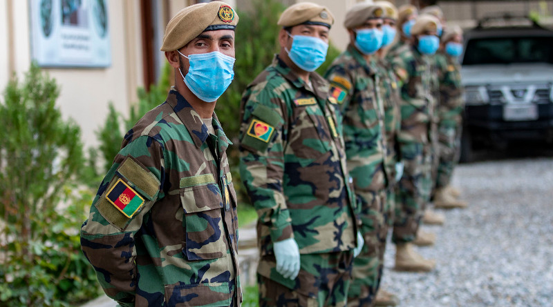 Afghan National Army commandos stand in formation wearing face masks during coronavirus pandemic. Photo Credit: Army Spc. Jeffery J. Harris