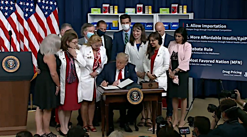 US President Donald Trump signs four Executive Orders to Lower prescription drug prices. Photo Credit: Screenshot White House video