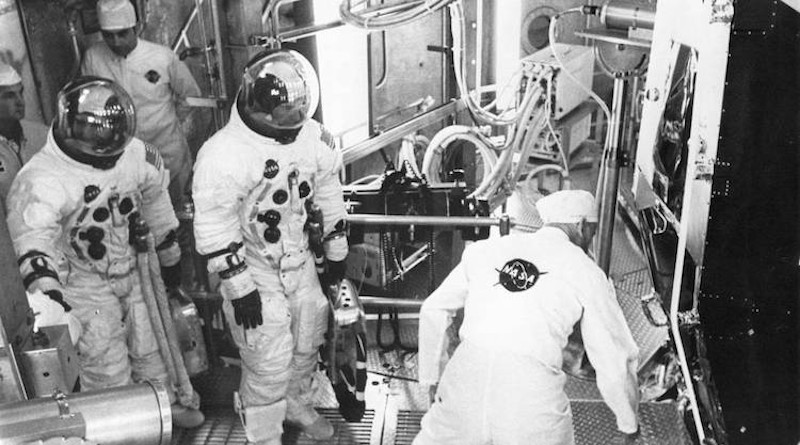 Apollo 11 backup crew members Fred Haise (left) and Jim Lovell prepare to enter the Lunar Module for an altitude test. Credit: NASA.
