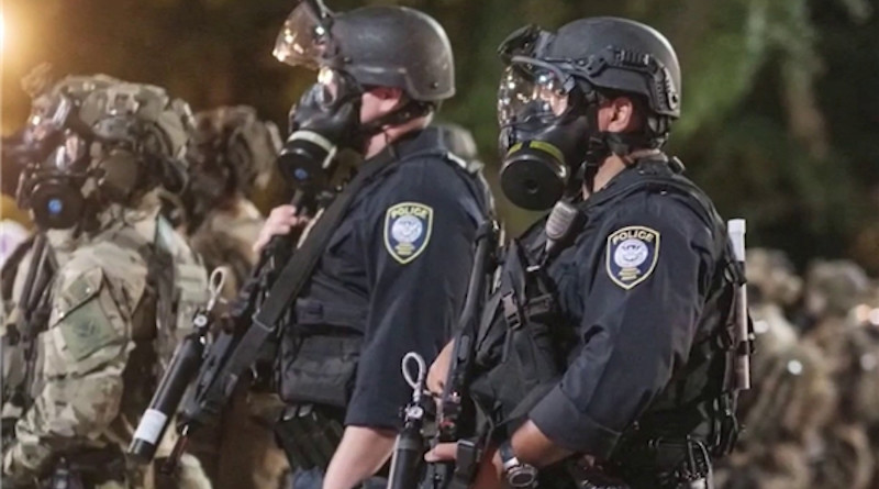 Police with alleged US Federal agents in Portland, Oregon. Photo Credit: Fars News Agency