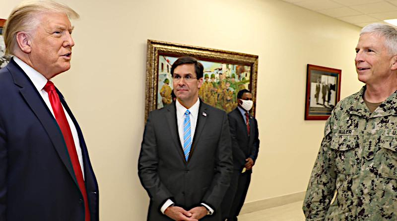 President Donald J. Trump talks with Defense Secretary Dr. Mark T. Esper and Navy Adm. Craig Faller, commander of U.S. Southern Command, at Southcom headquarters in Doral, Fla. Photo Credit: DoD